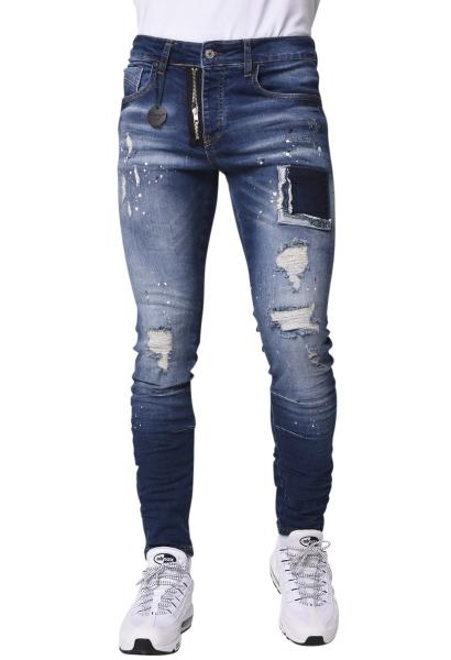 Jean skinny déchiré et tacheté de peinture avec zip apparent Brut used